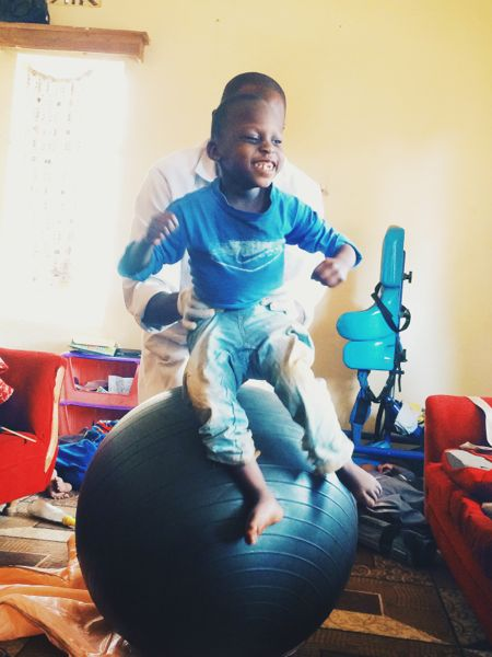Moses having a blast during physical therapy.
