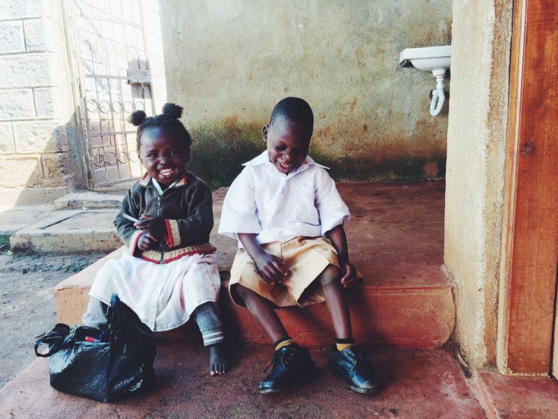 Moses enjoying recess at school with his friend Christine.
